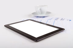Tablet, Tea on Financial Graph Charts Royalty Free Stock Photo