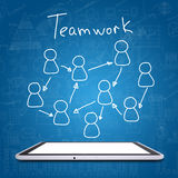 Tablet and teamwork sketch Royalty Free Stock Image