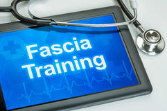 Tablet with the text Fascia training Stock Photos