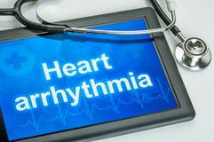 Tablet with the text Heart arrythmia the display stock photo