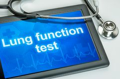Tablet with the text Lung function test. On the display royalty free stock images