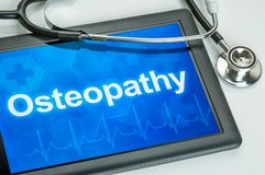Tablet with the text Osteopathy on the display Royalty Free Stock Images
