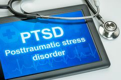 Tablet with the text PTSD the display stock photo