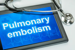 Tablet with the text Pulmonary embolism. On the display stock photo