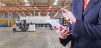 Tablet to handle export and import goods prepare the delivery Stock Image