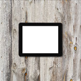 Tablet touch computer on a background of wood. Stock Photos