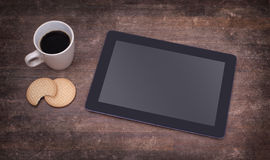 Tablet touch computer gadget on wooden table Royalty Free Stock Image
