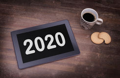 Tablet touch computer gadget on wooden table - 2020 Stock Photos