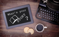 Tablet touch computer gadget on wooden table, what's your story Stock Images