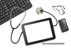 Tablet touch pad and office supplies on the table Stock Photo