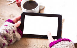 Tablet Touchscreen and Coffee Cup Stock Photos