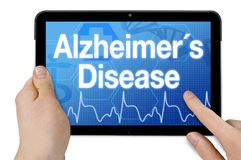Tablet with touchscreen and diagnosis alzheimers disease stock image
