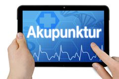 Tablet with touchscreen and the german word for acupunctre stock photography
