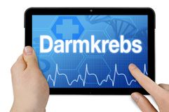 Tablet with touchscreen and the german word for colon cancer royalty free stock photo