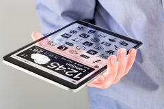 Tablet with transparent screen in human hands. Stock Images