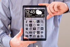 Tablet with transparent screen in human hands. Royalty Free Stock Image