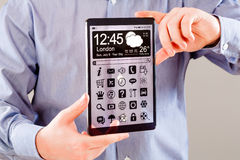 Tablet with transparent screen in human hands. Royalty Free Stock Images