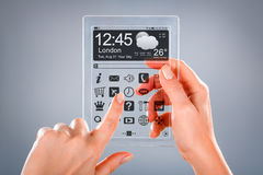Tablet with transparent screen in human hands. Royalty Free Stock Photography