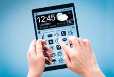 Tablet with transparent screen in human hands. Stock Photo