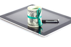 Tablet,tube of dollars and stylus Stock Images