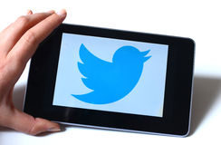 Tablet  Twitte. Twitter is an online social networking and microblogging service that enables users to send and read tweets Stock Photography