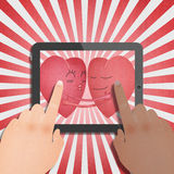Tablet with two red heart romantic Royalty Free Stock Photos