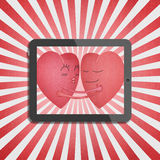 Tablet with two red heart romantic Stock Images