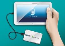 Tablet und Energie-Bank Stockfotografie