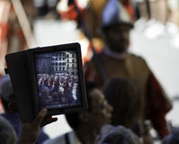 Tablet use during an Historical reenactment Stock Photography