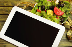 Tablet with vegetable salad Royalty Free Stock Photo
