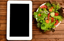 Tablet with vegetable salad Royalty Free Stock Photos