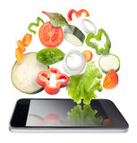 Tablet and vegetables isolated. Recipes application concept. Royalty Free Stock Image