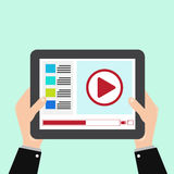 Tablet with video stream. Illustration hand holding a tablet with watching streaming video Stock Photography