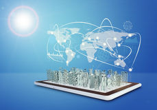 Tablet with virtual cityscape and world map Royalty Free Stock Photo