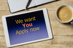 Tablet with we want you - apply now on table Royalty Free Stock Photos