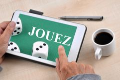 Tablet on which is written play in French royalty free stock photos