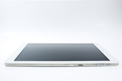 Tablet. White tablet close up in white background Royalty Free Stock Photo
