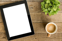 Tablet white screen display and coffee on table Stock Photography