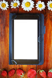 Tablet with a white screen lies on the wooden background Stock Photography