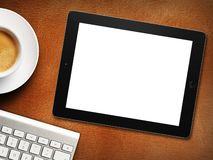 Tablet white screen similar to ipad display and coffee. On background royalty free stock photos