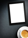 Tablet white screen similar to ipad display and coffee Stock Images