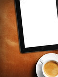 Tablet white screen similar to ipad display and coffee Royalty Free Stock Image