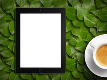 Tablet white screen similar to ipad display and coffee Royalty Free Stock Photography
