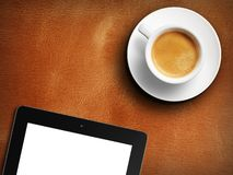Tablet white screen similar to ipad display and coffee royalty free stock photos