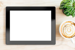 Tablet white screen on wood desk on top Royalty Free Stock Photo