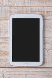 Tablet on white wood for work and background Royalty Free Stock Photos