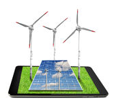 Tablet with a wind turbines and solar panel Royalty Free Stock Photos