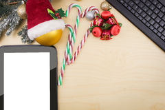 Tablet  with winter festive ornaments Stock Photography