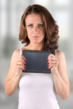 Tablet woman. Touchpad woman showing tablet PC Stock Image