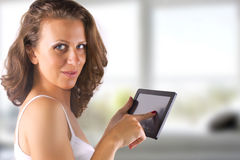 Tablet woman. Touchpad woman showing tablet PC Royalty Free Stock Photo